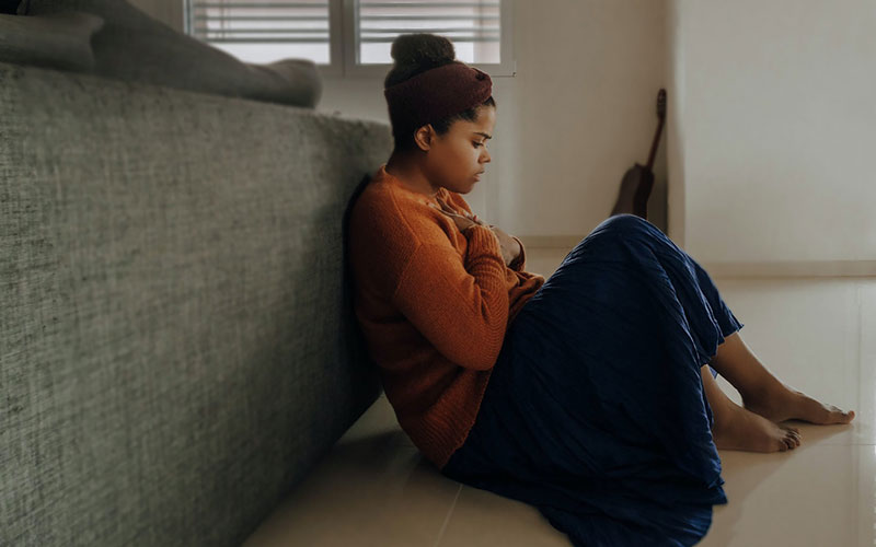 anxious female sitting on floor