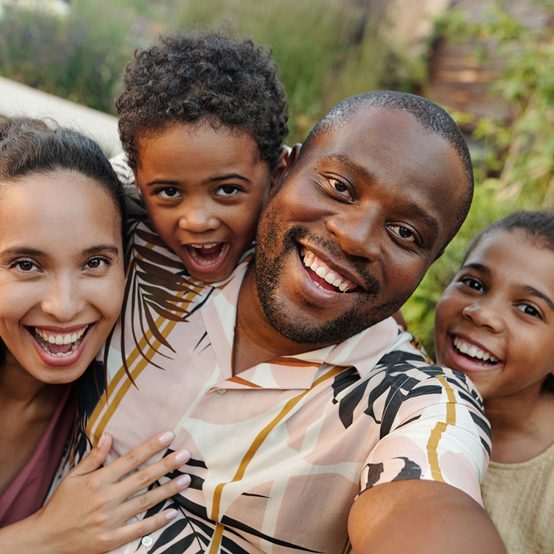 close up of family smiling